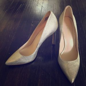 Never worn! 4 Inch Silver Stilettos